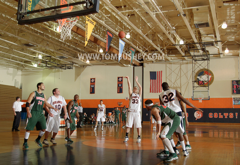 Middletown, NY - Connor Cornine (33) of SUNY Orange shoots a free throw against Rockland Community College in a Mid-Hudson Conference men's basketball game in Middletown on Feb. 26, 2008.