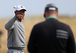 USA's Tiger Woods catches a ball on the driving range during preview day four of The Open Championship 2018 at Carnoustie Golf Links, Angus.