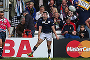Scotland's Mark Bennett celebrates scoring a try during the Rugby World Cup Pool B match between Scotland and Japan at the Kingsholm Stadium, Gloucester, United Kingdom on 23 September 2015. Photo by Shane Healey.