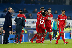 Swansea City's Leroy Fer (centre) celebrates with team-mates after scoring his team's opening goal as manager Paul Clement (left) looks on during the Premier League match at Goodison Park, Liverpool.