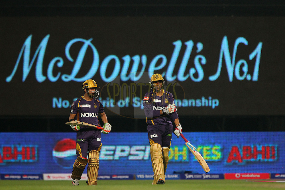 Gautam Gambhir and Manvinder Bisla take to the field for KKR during the opening match of the Pepsi Indian Premier League between the Kolkata Knight Riders and The Delhi Daredevils  held at the Eden Gardens Stadium in Kolkata on the 3rd April 2013..Photo by Ron GauntSPORTZPICS/IPL..Use of this image is subject to the terms and conditions as outlined by the BCCI. These terms can be found by following this link:..http://www.sportzpics.co.za/image/I0000SoRagM2cIEc