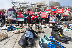 Missing Millions highlights the 21,000 people in Scotland who suffer from ME, also known as chronic fatigue system. Stuart Murdoch, lead singer of Belle and Sebastian, and author Ali Smith are supporting the campaign.<br /> <br /> Protesters stand in front of rows of empty shoes to represent people with ME missing from their lives. <br /> <br /> Pictured: Campaigners outside the Scottish Parliament behind the shoes of people missing from their lives