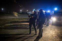"""Ausschreitungen vor Räumung des Flüchtlingslagers Dschungel von Calais / 231016<br /> <br /> ***Calais, Pas-de-Calais, France - 23.10.2016 Last day of the of the so called """"Jungle"""" refugee camp on the outskirts of the French city of Calais before the scheduled eviction. Many thousands of migrants and refugees are waiting in some cases for years in the port city in the hope of being able to cross the English Channel to Britain. French authorities announced that they will shortly evict the camp where currently up to up to 10,000 people live.***<br /> <br /> [Letzter Tag des sogenannten Jungle Fluechtlingscamp am Rande der franzoesischen Stadt Calais vor der angesetzten Raeumung. Viele tausend Migranten und Fluechtlinge harren teilweise seit Jahren in der Hafenstadt aus in der Hoffnung den Aermelkanal nach Großbritannien ueberqueren zu koennen. Die franzoesischen Behoerden kuendigten an, dass sie das Camp, indem derzeit bis zu bis zu 10.000 Menschen leben Kürze raeumen werden.]"""