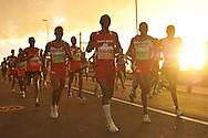 Sunrise for front runners approaching Kalk Bay during the 2 Oceans Ultra Marathon held in and around Cape Town and the Cape Peninsular on the 7th April 2012..Photo by Jurie Senekal/SPORTZPICS