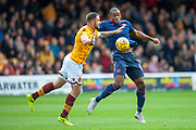 Uche Ikpeazu (#19) of Heart of Midlothian challenges Peter Hartley (#6) of Motherwell FC during the Ladbrokes Scottish Premiership match between Motherwell and Heart of Midlothian at Fir Park, Motherwell, Scotland on 15 September 2018.