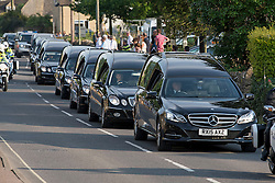 © Licensed to London News Pictures. 01/07/2015. 8 Hearses carrying the bodies of  bodies of 8 British people killed in Tunisia, leave RAF Brize Norton and travel through the town or Carterton in Oxfordshire  as they are repatriated to the UK. 38 people were killed when gunman Seifeddine Rezgui opened fire on holiday makers at the resort of Sousse in Tunisia. Photo credit: Ben Cawthra/LNP