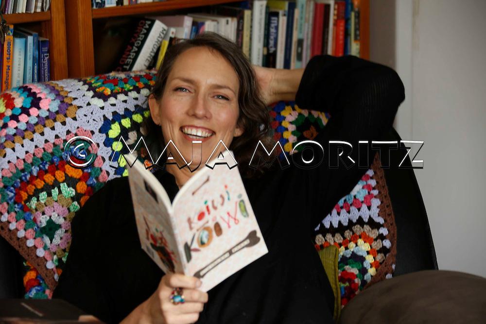 "Hinemoana Baker, a poet and musician, at home with her new book ""k?iwi k?iwi bone bone"", Kapiti Coast, near Wellington, New Zealand"