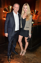 EDWARD HANSON and AGATA MAZUR at the OMEGA VIP dinner hosted by Cindy Crawford and OMEGA President Mr. Stephen Urquhart held at aqua shard', Level 31, The Shard, 31 St Thomas Street, London, SE1 9RY on 10th December 2014.
