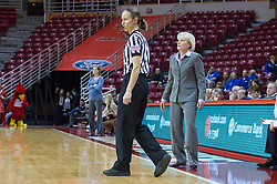 03 January 2014:  Referee Lisa Mattingly keeps an eye on the action while moving around Head Coach Barb Smith during an NCAA women's basketball game between the Drake Bulldogs and the Illinois Sate Redbirds at Redbird Arena in Normal IL