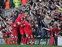 Photo: Lee Earle.<br /> Liverpool v Manchester United. The FA Cup. 18/02/2006. Liverpool players celebrate with Peter Crouch after he scored the winning goal.