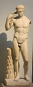 Roman statue of a victorious young athlete. 1st century AD. Remade from a Greek original of about 430 BC. The athlete shown tying a ribbon around his head showing his victory in competition.