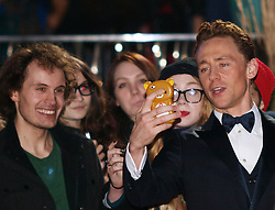 Actor Tom Hiddleston, right, with his fans as he arrives for the World Premiere of his latest film Thor The Dark World.  in London's Leicester Square, England, United Kingdom. Tuesday, 22nd October 2013. Picture by Max Nash / i-Images