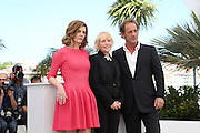 Claire Denis (C) poses on May 22, 2013 with French actors Chiara Mastroianni (L) and Vincent Lindon attend the 'Les Salauds' Photocall during the 66th Annual Cannes Film Festival at the Palais des festivals on May 22, 2013 in Cannes, France