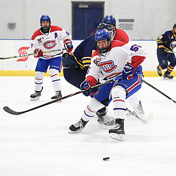 TORONTO, ON  - JAN 7,  2018: Ontario Junior Hockey League game between the Toronto Jr. Canadiens and the Buffalo Jr. Sabres, Chase Spencer #55 of the Toronto Jr. Canadiens battles for the puck during the second period.<br /> (Photo by Andy Corneau / OJHL Images)