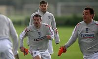 Photo: Paul Thomas.<br />England training session. 04/10/2006.<br /><br />(L-R) Jamie Carragher, Steven Gerrard and John Terry.