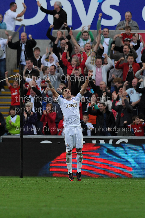 Swansea city's Pablo Hernandez (11) celebrates after he scores the opening goal. Barclays Premier league, Swansea city v Wigan Athletic at the Liberty Stadium in Swansea, South Wales on Saturday 20th October 2012. pic by Andrew Orchard, Andrew Orchard sports photography,
