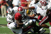 South Carolina players make a tackle against Alabama at Williams-Brice Stadium. (Photo by Joe Robbins)