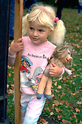 Girl with Miss Piggy doll at Catholic School bike-a-thon age 3.  St Paul Minnesota USA