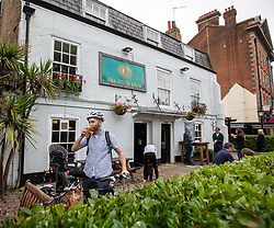 © Licensed to London News Pictures. 04/07/2020. London, UK. William Brewer 39 from Richmond enjoys his first pint at the Sun Inn on Barnes Ponds, South West London as members of the public flock to pubs, restaurants, hairdressers, hotels and campsites for the first time in over 100 days as the unlocking of the coronavirus pandemic restrictions continues.  Photo credit: Alex Lentati/LNP