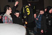 31.JANUARY.2011. LIVERPOOL<br /> <br /> FANS BURN A FERNANDO TORRES LIVERPPOL NO.9 SHIRT OUTSIDE LIVERPOOL'S TRAINING GROUND MELWOOD AS  HE IS LEAVING LIVERPOOL FOR CHELSEA IN A &pound;50 MILLION POUND TRANSFER.<br /> <br /> BYLINE: EDBIMAGEARCHIVE.COM<br /> <br /> *THIS IMAGE IS STRICTLY FOR UK NEWSPAPERS AND MAGAZINES ONLY*<br /> *FOR WORLD WIDE SALES AND WEB USE PLEASE CONTACT EDBIMAGEARCHIVE - 0208 954 5968*
