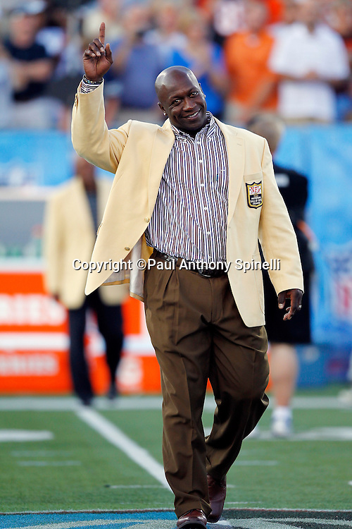 Former Minnesota Vikings defensive tackle and NFL Pro Football Hall of Fame Class of 2010 Inductee John Randle waves and smiles as he is introduced prior to the NFL Pro Football Hall of Fame preseason football game between the Dallas Cowboys and the Cincinnati Bengals on Sunday, August 8, 2010 in Canton, Ohio. The Cowboys won the game 16-7. (©Paul Anthony Spinelli)