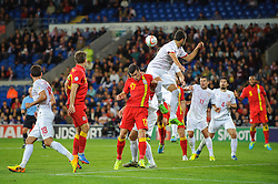 Gareth Bale of Wales (Real Madrid) in action as a corner ball comes in during the second half of the match - Photo mandatory by-line: Rogan Thomson/JMP - Tel: Mobile: 07966 386802 10/09/2013 - SPORT - FOOTBALL - Cardiff City Stadium - Cardiff -  Wales V Serbia- World Cup Qualifier.