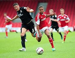 Bristol City's Bobby Reid sprints past Bournemouth's Tommy Elphick - Photo mandatory by-line: Dougie Allward/JMP - Tel: Mobile: 07966 386802 27/03/2013 - SPORT - FOOTBALL - Goldsands Stadium - Bournemouth -  Bournemouth V Bristol City - Pre Season friendly