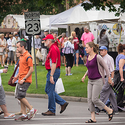 Pedestrians walking across High Street during the Worthington Art Festival and Farmer's Market Saturday June 21, 2014. (Christina Paolucci, photographer).