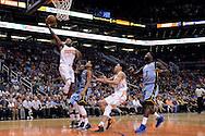 Mar 21, 2016; Phoenix, AZ, USA; Phoenix Suns forward P.J. Tucker (17) drives the ball against the Memphis Grizzlies in the first half at Talking Stick Resort Arena. Mandatory Credit: Jennifer Stewart-USA TODAY Sports