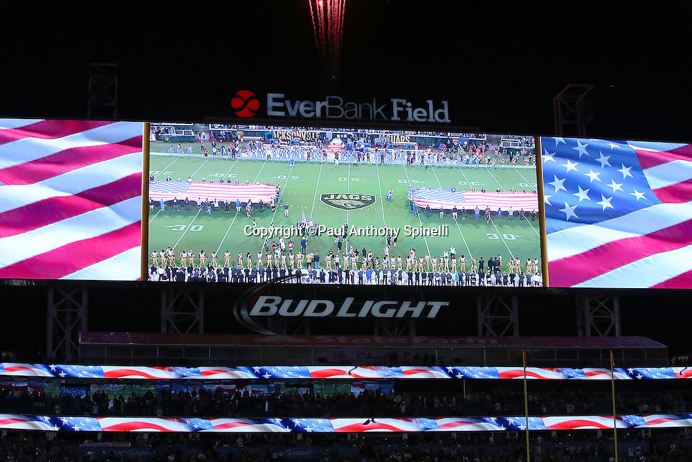 The giant scoreboard is lit up with a pregame American flag tribute during the playing of the National Anthem before the Jacksonville Jaguars 2015 week 11 regular season NFL football game against the Tennessee Titans on Thursday, Nov. 19, 2015 in Jacksonville, Fla. The Jaguars won the game 19-13. (©Paul Anthony Spinelli)