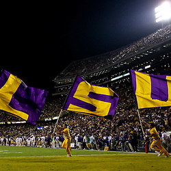 November 13, 2010; Baton Rouge, LA, USA; LSU Tigers cheerleaders carry flags following a touchdown during a game against the Louisiana Monroe Warhawks at Tiger Stadium. LSU defeated Louisiana-Monroe 51-0.  Mandatory Credit: Derick E. Hingle