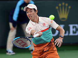 March 8, 2019 - Indian Wells, CA, U.S. - INDIAN WELLS, CA - MARCH 08: Kei Nishikori (JPN) returns a shot in the first set of a doubles match during the BNP Paribas Open played at the Indian Wells Tennis Garden in Indian Wells, CA. (Photo by John Cordes/Icon Sportswire) (Credit Image: © John Cordes/Icon SMI via ZUMA Press)