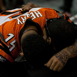Dec 22, 2009; Westwego, LA, USA;  Family member with a tatoo and jersey of Chris Henry mourns during funeral services for Cincinnati Bengals wide receiver Chris Henry held at the Alario Center. Mandatory Credit: Derick E. Hingle-US PRESSWIRE