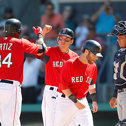 February 28, 2011; Fort Myers, FL, USA; Boston Red Sox first baseman David Ortiz (34) is greeted by teammates after hitting a homerun during a spring training exhibition game against the Minnesota Twins at City of Palms Park.  Mandatory Credit: Derick E. Hingle-US PRESSWIRE
