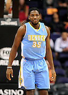 Nov. 12, 2012; Phoenix, AZ, USA; Denver Nuggets forward Kenneth Faried (35) stands on the court in the game against the Phoenix Suns at US Airways Center. The Suns defeated the Nuggets 110-100. Mandatory Credit: Jennifer Stewart-USA TODAY Sports.