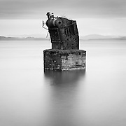 Boiler Relic, Columbia River, Astoria.  This repurposed ship's boiler, once located at the heart of a thriving fish processing and packing industry, stands as a stark reminder of the boom years for Astoria's waterfront beginning in the 1880s.  Astoria, Oregon, USA.