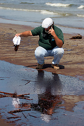 21 May 2010. Grand Isle, Lafourche Parish, Louisiana. .BP Macondo Well disaster. Christopher Hernandez, street superintendent of Grand Isle patrols the closed beaches. Oil washes ashore in greater concentrations than previously seen on the once pristine beaches of Grand Isle. The economic and environmental impact is devastating with shrimp boats tied up, vacation rentals and charter boat fishing trips cancelled as police chase tourists from the beaches just two hours drive from New Orleans..Oil from the Deepwater Horizon catastrophe is evading booms laid out to stop it thanks in part to the dispersants which means the oil travels at every depth of the Gulf and washes ashore wherever the current carries it. .Photo credit; Charlie Varley.