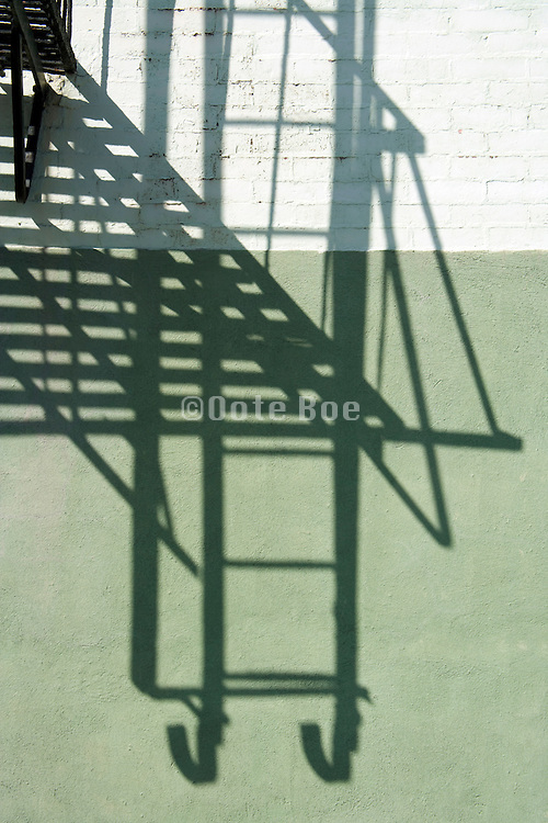 shadow of fire escape balcony and ladder