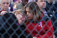 A young woman is consoled at Jonathan Law High School during a vigil for slain student Maren Sanchez in Milford, Connecticut April 28, 2014. Sanchez, 16 was killed on Friday in a stairwell at the school by a classmate who may have been upset that she rebuffed his invitation to the prom, police said. The prom was postponed after the incident. REUTERS/Michelle McLoughlin (UNITED STATES - Tags: CRIME LAW EDUCATION)