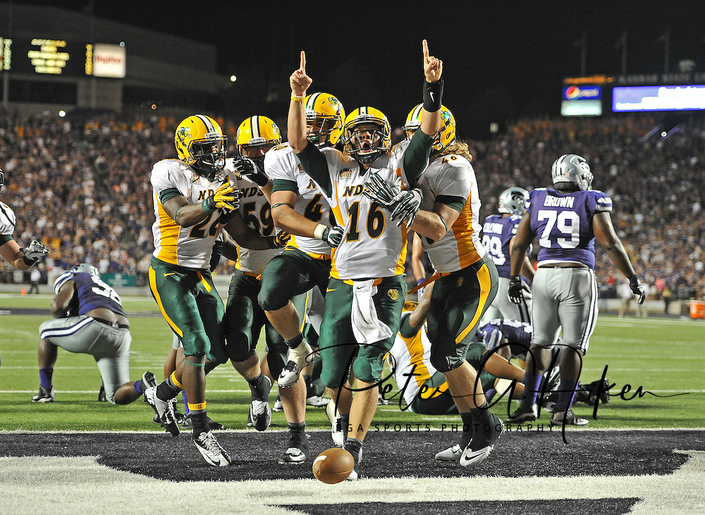 Sports Illustrated -- Quarterback Brock Jensen #16 of the North Dakota State Bison celebrates with his teammates after scoring the go ahead touchdown against the Kansas State Wildcats late in the fourth quarter on August 30, 2013 at Bill Snyder Family Stadium in Manhattan, Kansas.