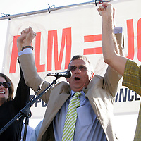 State Representative Susi Hamilton, left, State Senator Bill Rabon, center, and State Senator Thom Goolsby take the stage together during a pro film incentives rally Sunday May 4, 2014 in Wilmington, N.C. (Jason A. Frizzelle)