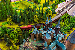 A model train rushes past a fantastical stale in a lush landscape on the Hornby stand at the Toy Fair at Kensington Olympia in London, the UK's largest dedicated game and hobby exhibition featuring the hottest and most anticipated products for the year ahead. London, January 22 2019.