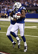 Indianapolis Colts running back Dion Lewis (28) gets a pat on the helmet from Indianapolis Colts strong safety Mike Adams (29) after Lewis intercepts a second quarter pass during the NFL week 2 regular season football game against the Philadelphia Eagles on Monday, Sept. 15, 2014 in Indianapolis. The Eagles won the game 30-27. ©Paul Anthony Spinelli