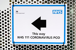 © Licensed to London News Pictures. 02/03/2020. London, UK.  A sign directing patients to a National Health Service 111 Coronavirus pod positioned at the UCH hospital positioned at the UCH hospital in London. The pod will allow doctors to examine patients who may be feeling symptoms of the virus. Photo credit: Ray Tang/LNP