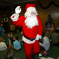 Edrington Group Childrens Christmas party  19.12.02<br />Santa leaves<br /><br />Pic by Graeme Hart<br />Copyright Perthshire Picture Agency<br />Tel: 01738 623350 / 07990 594431