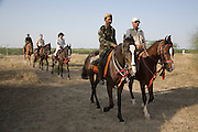 Rider arriving back at camp on Marwari horses at the Mallinath Fair at Tilwara  near Balotra, Rajasthan, India