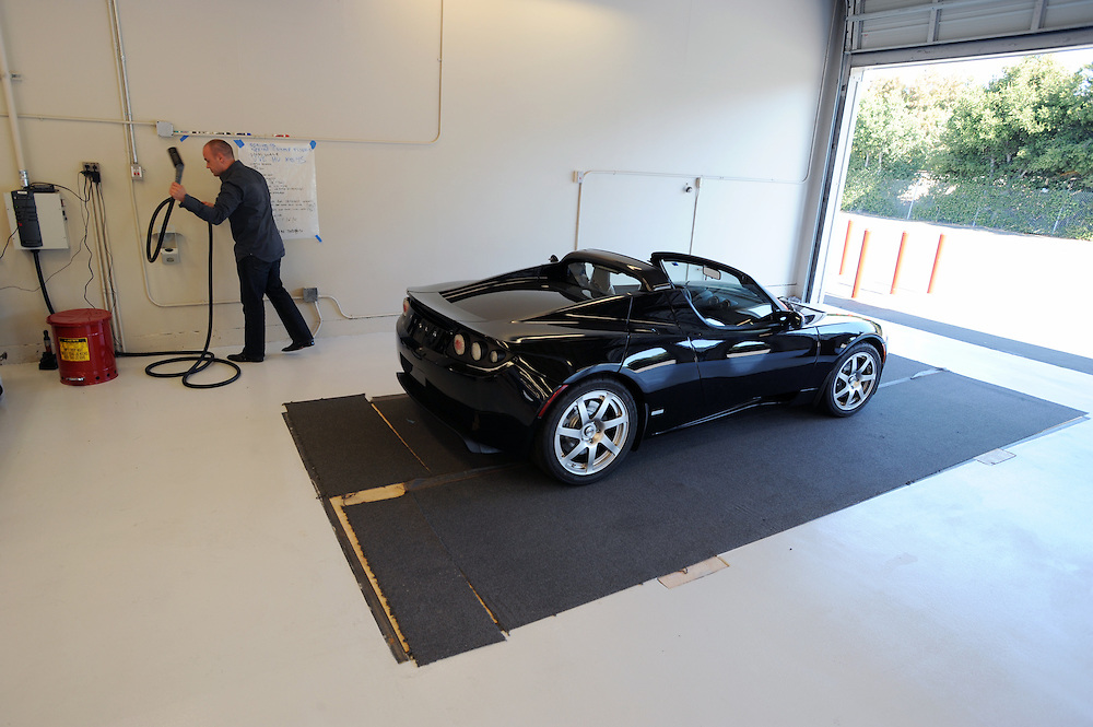Client advisor Jeremy Cleland charges a 2008 roadster at Tesla Motors Inc.  The California  based company builds electro luxury cars.The 2008 Tesla Roadster is an electric sports car that accelerates from 0 to 60 MPH in 3.9 sec..Alternative Energy in Silicon Valley and the San Francisco Bay Area