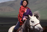 Mongolia. girl riding a horse in the steppe, on the outskirts of Ulan Bator.   /  jeune Cavaliere sur  la steppe à la sortie de Oulan bator  /    /  R221/22