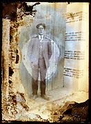 eroding glass plate photo with young adult man posing