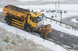 © Licensed to London News Pictures. 15/01/2013..Saltburn, Cleveland, England..As heavy snow falls on Saltburn the notorious Saltburn Bank becomes almost impassable. The graters managed to spread some salt down allowing cars to make it up the bank...Photo credit : Ian Forsyth/LNP